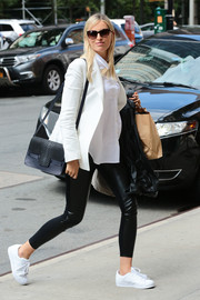 Karolina Kurkova teamed a pair of mixed-material leggings with a white blazer for a day out in the city.