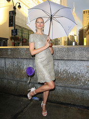 Karolina Kurkova looked very refined in a silver lace cocktail dress by Marchesa while out during New York Fashion Week.