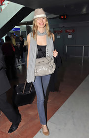 Model Karolina Kurkova showed off her airport style while arriving at Nice airport. Her leather bag is perfect for traveling.