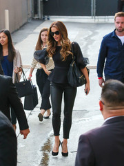 Kate Beckinsale cut a feminine silhouette in a black Saloni peplum top with sheer blouson sleeves while headed to 'Kimmel.'