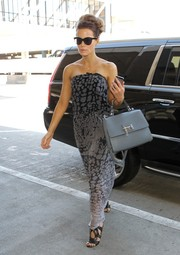 Kate Beckinsale was beach-chic at the airport in a strapless gray maxi dress.