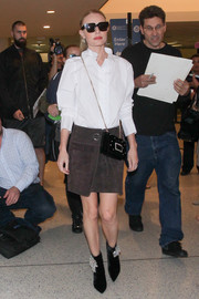 Kate Bosworth styled her outfit with bedazzled black boots by Roger Vivier.