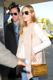 Kate Bosworth caught a flight at LAX sporting this luxe metallic-gold Marni bag and pink fur coat combo.