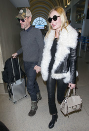 Kate Bosworth oozed rock-star appeal wearing this fur-trimmed leather jacket while making her way through LAX.