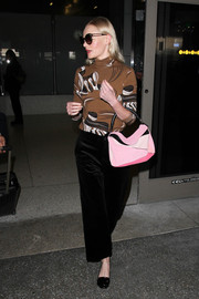 Kate Bosworth chose a pair of black velvet slacks to team with her sweater.