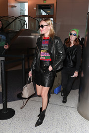 Kate Bosworth was spotted at LAX wearing a black leather jacket by Anine Bing.