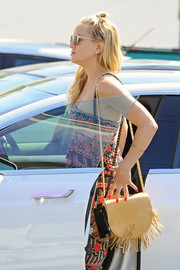 Kate Hudson accessorized with a fringed nude shoulder bag by Meli Melo for a day out.