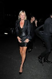 Ruffled cuffs and a luxe sheen gave Kate Moss' jacket an added air of refinement.