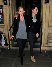 Kate Moss dressed up her v-neck tee with this black blazer with satin lapels.
