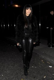 Zara Martin added a dose of sparkle to her all-black look with a pair of sequined skinnies.