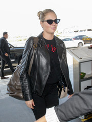 Kate Upton looked cool wearing these Le Specs x Adam Selman cateye sunnies while catching a flight out of LAX.