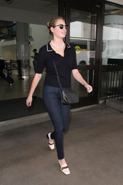 Kate Upton completed her airport outfit with a pair of Gucci loafer heels.