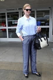 Kate Upton went for a mannish airport look with this pastel-blue button-down with a white collar and cuffs.