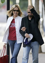 Barbara Bach wore a chic white jacket with her tee and jeans for a smart finish.