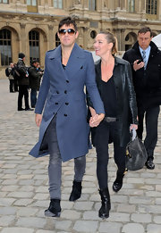 Kate Moss attended the Louis Vuitton show in flat black leather mid-calf boots.