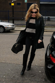 Kate Moss looked stylish as ever in a pair of slouchy black leather knee high boots.