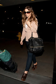 Kate Beckinsale carried an oversize black leather zippered tote to LAX.