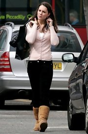 Kate kept comfy in tan sheepskin boots.