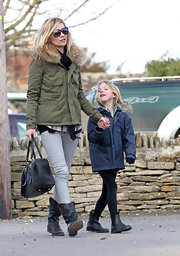 Wearing comfy black boots, Lila went for a walk with mom Kate.
