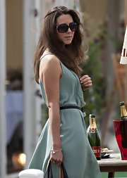 Kate Middleton shaded her eyes at a Polo Match in large oversize sunglasses.