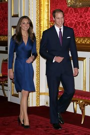 Kate looked elegant in black timeless pumps. She paired the heels to a chic navy long sleeved dress for a perfectly royal look.