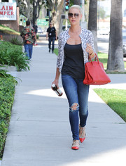 Katherine Heigl teamed her jeans with a leopard-print cardigan and a black tank top.