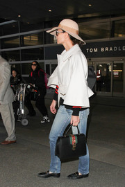 Katie Holmes was spotted at LAX carrying a stylish Gucci tote.