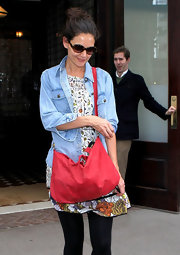 Katie Holmes looked surprisingly summery in NYC wearing a denim jacket over a flirty sun dress.