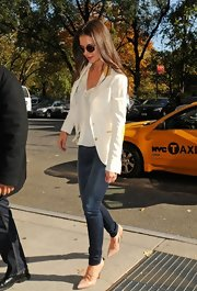 Katie Holmes was casual chic in dark jeans paired with a white blazer and classic nude pumps.