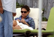 Katie Holmes sported a pair of oval sunnies by Tom Ford while relaxing by the pool.