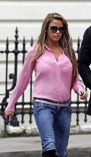 Katie Price kept things surprisingly classic in a pink button up top and jeans.