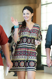 Katrina Law waved to photographers at Comic-Con in a boho-chic tunic dress.
