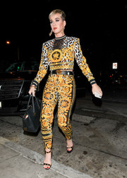 Katy Perry matched her top with a pair of printed skinny pants, also by Versace.