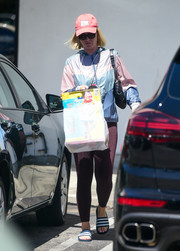Katy Perry stayed comfy in burgundy leggings and a multicolored hoodie while out in Los Angeles.