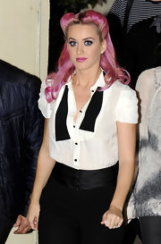 Katy Perry rocked a reverse roll at a live taping of 'The X Factor: UK'. With her pink tresses, the 40s-inspired 'do looked ultra modern.