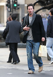 Actor Keanu Reeves kept warm with a gray wool scarf.