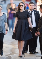 Keira Knightley made her way to 'Jimmy Kimmel' looking sweet in a black Orla Kiely maternity dress with a bowed shoulder and a pleated skirt.