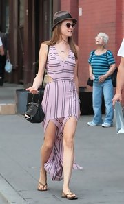 Behati Prinsloo went for a breezy summer look with a striped pink sundress that featured a deep-V neckline, a back-baring cutout, and double slits.