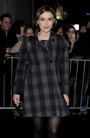 Keira looks classically sweet in a plaid wool coat after her performance in 'The Children's Hour.'