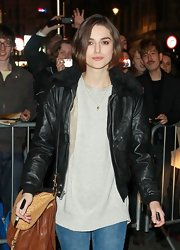 Keira switches up her look with a fur trimmed leather jacket after her theater performance.