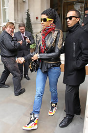 Kelis was spotted leaving her hotel showing she is still a kid at heart by wearing Jeremy Scott for Adidas original Mickey Mouse sneakers. The rest of her look included jeans, a Givenchy Resort 2010 leather studded jacket and a Vivienne Westwood bag.