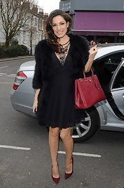 To add just a touch of old-school glamour to her everyday look, Kelly Brook sported this black fur coat.
