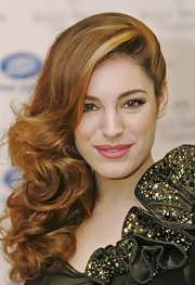 Kelly Brook paired her flawless skin with cherry red lip gloss.