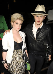 Looking a little like Billy Idol, Kelly Osbourne sports an '80s hair-style while out with boyfriend Luke Worrell.