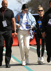 Kendall Jenner teamed her jacket with a pair of ecru jeans by Martine Rose.