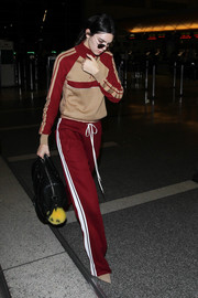 Kendall Jenner completed her outfit with red side-striped sweatpants, also by Chloe.