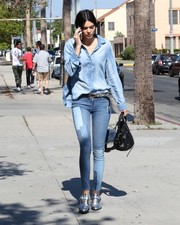 Kendall Jenner styled her outfit with silver booties by Barbara Bui.