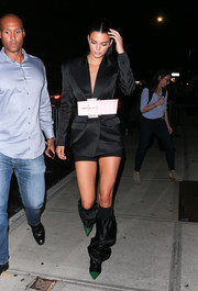 Kendall Jenner sealed off her look with a pair of slouchy knee-high boots.