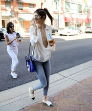 Kendall Jenner teamed her revealing top with a pair of skinny jeans by Mother.