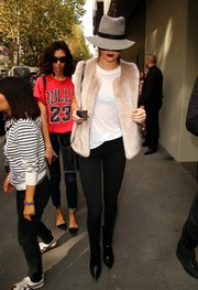 Kendall Jenner glammed up a casual white tee with a Topshop fur vest for a day out in Milan.